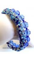 Csavart csiszolt karkötő, kék mix